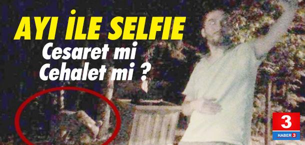Ormanda ayıyla selfie yaptı